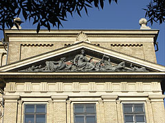 "The pediment of the main building of the Eötvös Loránd University (ELTE) Faculty of Humanities (BTK) with a triangular tympanum, including the ""Mineralogy"" sculpture group - Budapešť, Maďarsko"