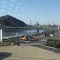 Looking through the glass wall of the Bálna at the Danube bank of Ferencváris district, the Szabadság Bridge (or Liberty Bridge) and the Gellért Hill - Budapešť, Maďarsko