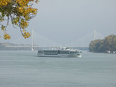 "The Megyeri Bridge (or ""M0 Bridge"") viewed from the ""Római-part"" section of the riverbank, as well as the ""Royal Amadeus"" riverboat in the foreground - Budapest, Ungheria"