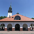 The building of the bus terminus, as well as the white steeple (tower) of the Reformed church - Nagykőrös, Ungheria