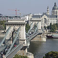 "The Széchenyi Chain Bridge (""Lánchíd"") over the Danube River, as well as the Gresham Palace and the dome of the St. Stephen's Basilica, viewed from the Buda Castle Hill - Будапеща, Унгария"