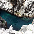 Deep blue water surrounded by rocks - Дубровник, Хърватия