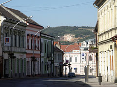The view of the main street with shops and residental houses - Siklós (Sieglos), Ungarn