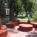 Modern style wooden benches in the park of the Veterinary Science University - Boedapest, Hongarije