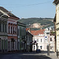 The view of the main street with shops and residental houses - Siklós, Hongarije