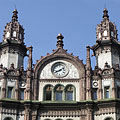 The pediment on the top of the Brudern Palace with small towers (turrets) and a clock - Budapest, Ungari