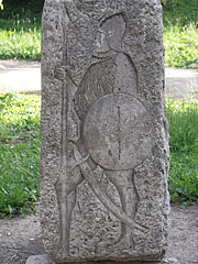Medieval suldier figure on the Mihály Hörmann's stone memorial sculpture close to the castle walls - Kőszeg, Ungari