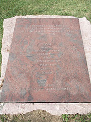 Red marble memorial plaque for the 50th anniversary of declaring Ajka as a town, including the names of the settlement parts - Ajka, Hungary