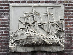 "A ship shaped relief on the wall of the ""De Haven van Texel"" Restaurant - Amsterdam, Netherlands"