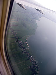 Above Amsterdam and below the clouds, in misty weather (view from the window of the airliner) - Amsterdam, Netherlands