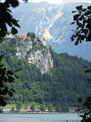 The castle of Bled on the top of a cliff, viewed from the lake - Bled, Slovenia