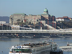"The Buda Castle Royal Palace (""Budavári Palota""), as well as the Royal Garden Pavilion (""Várkert-bazár"") that is just under renovation, both can be seen behind the Elisabeth Bridge - Budapest, Hungary"