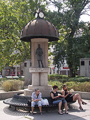 Street clock and benches, and the statue of Frigyes Podmaniczky politician and writer - Budapest, Hungary
