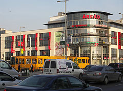 Car traffic and a tram 3 on the Fehér Road, and in the background it is the Árkád Shopping Center - Budapest, Hungary