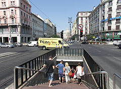 The stairs of the pedestrian underpass and the crossroads looking towards the Károly Boulevard - Budapest, Hungary