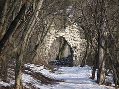 The stone gate of the Árpád Lookout viewed from the forest trail - Budapest, Hungary