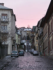 Cobblesoned street with stairway at the end of it, at sunset - Budapest, Hungary