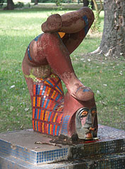 Clown Fountain, terracotta-(reddish-brown)-colored stone sculpture and fountain with mosaic inlay - Budapest, Hungary