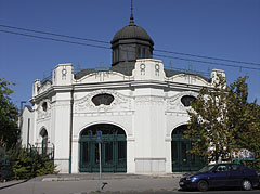 The white listed building is a historical carousel (merry-go-round) from 1906 - Budapest, Hungary
