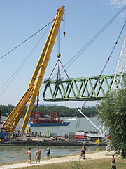 Crane ships are working on the reconstruction of the Újpest Railway Bridge - Budapest, Hungary