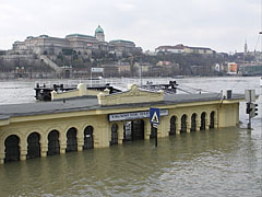 The Vigadó Square boat station is under the water, and on the other side of the Danube it is the Royal Palace of the Buda Castle - Budapest, Hungary