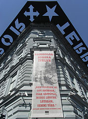 The corner of the House of Terror Museum with the astounding black decoration on the edge of the building - Budapest, Hungary