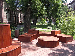 Modern style wooden benches in the park of the Veterinary Science University - Budapest, Hungary