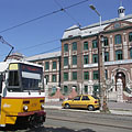 Yellow tram 14 in front of the bilingual secondary school - Budapest, Hungary
