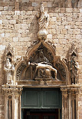 Pietà on the late-gothic facade of the Franciscan Monastery, above the door - Dubrovnik, Croatia