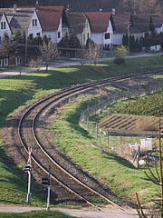 Curved rails and a railway crossing - Eplény, Hungary