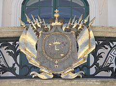 The gold-plated crest of the Esterházy family on the balcony of the palace - Fertőd, Hungary