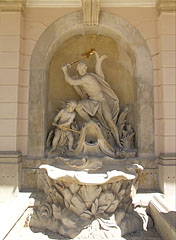 """Hercules (Heracles) is fighting with a giant fish"" rococo water spouting sculpture group in a wall niche of the palace - Fertőd, Hungary"
