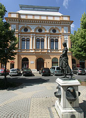 "The former Hotel Lehel (""Lehel Szálló"") and the ""Girl with a Pitcher"" statue in front of it - Jászberény, Hungary"