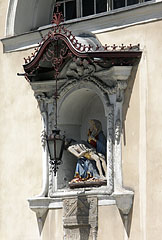 Pietà statue (Virgin Mary cradling the dead body of Jesus Christ) on the wall of the Cathedral - Ljubljana, Slovenia
