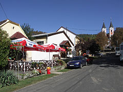 Street view with restaurants and the Pilgrimage Church - Máriagyűd, Hungary