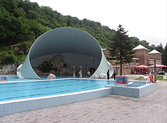 The outdoor shell pool with its characteristic cylindrical roof that was built in the 1960s - Miskolc, Hungary