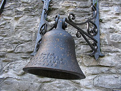 Small bell on the wall of the old smelter of Újmassa - Ómassa, Hungary