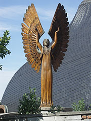 "The left figure in the ""Angels of the light and the darkness"" wooden sculpture group - Paks, Hungary"