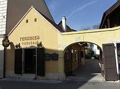The tiny yellow facade of the Ferences Vendéglő Restaurant - Pécs, Hungary