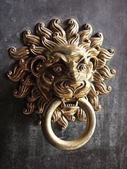A lion head bronze knocker on the door of the Cathedral of Pécs - Pécs, Hungary