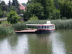 Pier near the Árpád Bridge with a berthed smaller riverboat - Ráckeve, Hungary
