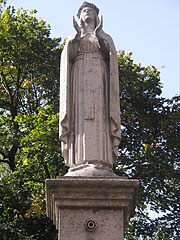 The old Virgin Mary Statue stands here on the column in front of the Holy Trinity Church since 1988 - Siklós, Hungary