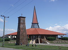 The St. Joseph the Worker Roman Catholic Church and its wooden belfry at the edge of the town - Szerencs, Hungary