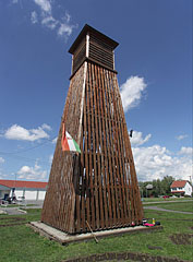 The separate wooden belfry (bell-tower) of the St. John the Worker Church - Szerencs, Hungary