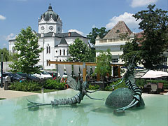 "The ""Mating dance of the mayflies"" or ""Tiszavirág couple"" fountain sculpture, the Szolnok Gallery and the terrace of the Galéria Retaurant on the new square - Szolnok, Hungary"