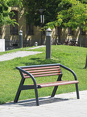 Grassy park with a seat and modern illuminators - Szolnok, Hungary