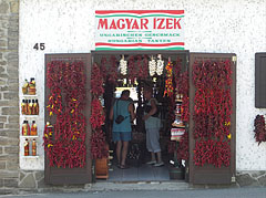 """Shop of the Hungarian flavors"", with many garlands of red paprika on its wall - Tihany, Hungary"