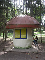 Mushroom-shaped kiosk (maybe a closed snack bar) in the mansion park - Tóalmás, Hungary