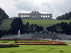 The Great Parterre (spacious Baroque formal garden) with the Neptune Fountain and the Gloriette on the hill - Vienna, Austria